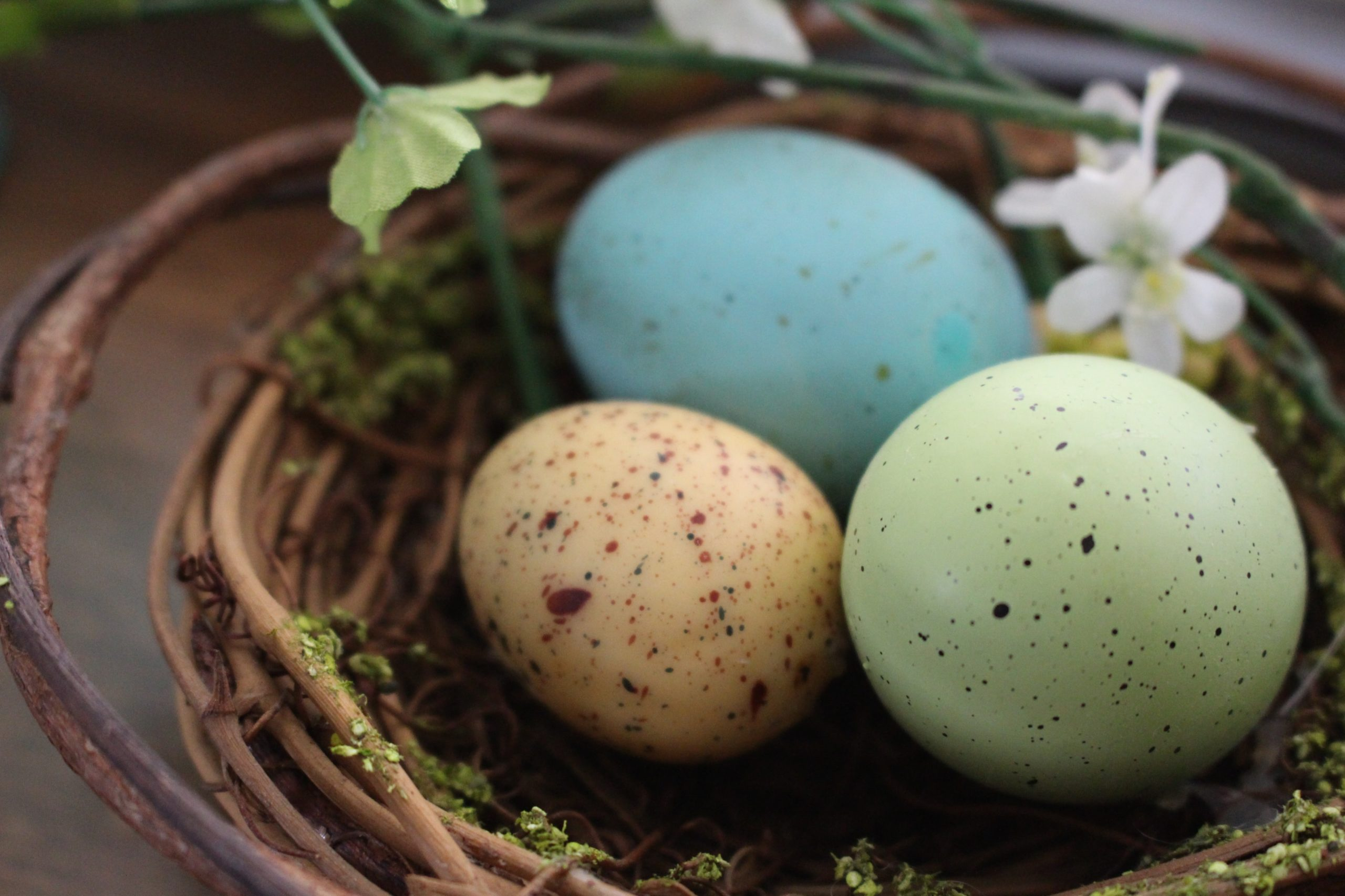 Pastel colored Easter eggs in basket