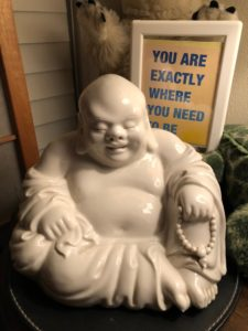 """Buddha and sign:""""You are exactly where you need to be"""""""